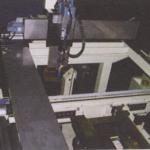 サンルーフモール自動接着装置